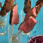 Sesame glazed fillet of beef skewers
